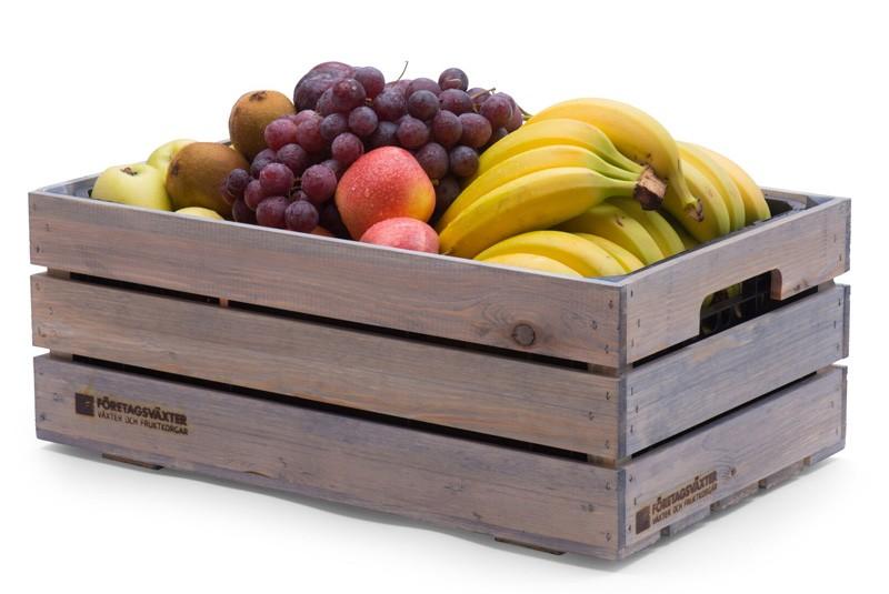 Frukt på arbetsplatsen med fruktkorg favorit